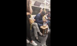 UK man makes a cup of tea with a jug and kettle while on the tube