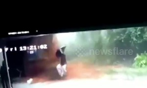 Dramatic moment a man escapes a landslide, while his family is trapped