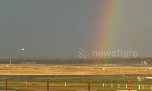 Plane lands at German airport with a stunning rainbow backdrop