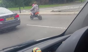 Biker Runs Red Light with Baby Onboard