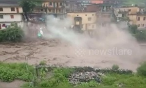 Home collapses in deadly northern India flash floods