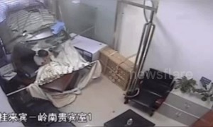 Out of control minibus steams across road and crashes through bank in southern China