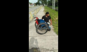 Heartwarming moment disabled man climbs out of wheelchair to save kitten stuck in drain in Malaysia