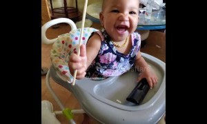 Adorable baby laughs uncontrollably having epic 'sword fight battle' with dad