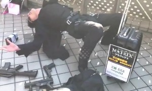 Street performer does incredible Matrix bullet dodging pose at Japanese comic festival