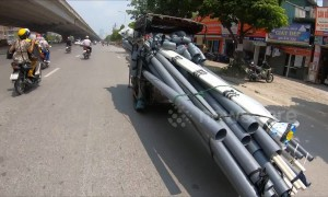 Cargo car in Vietnam seems to be carrying everything including kitchen sink