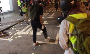 Hong Kong protester uses steel bowl to neutralise tear gas canister