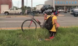 Man Rides His Bike the Hard Way