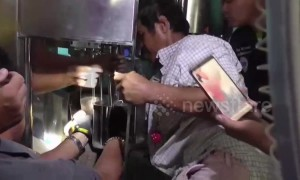 Thai worker rescued after getting hand stuck in water bottling machine