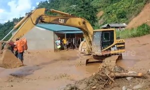 Excavator used to transport people trapped by flooding in Vietnam