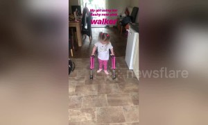 Little girl takes first steps after being told she could never walk