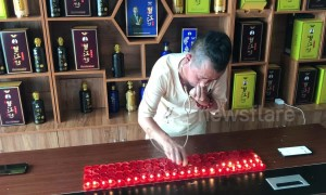 Kung fu master blows out 120 candles using EARS