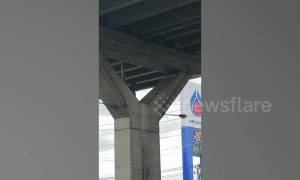 Thai man rants at the top of concrete motorway pillar