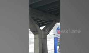 Thai man rants at the top of concrete motorway pillar