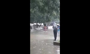 Ingenious way to cross a flooded road