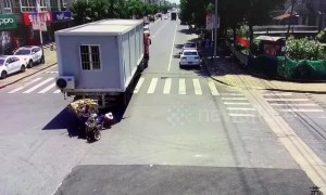 Woman run over by truck after falling out of a three-wheeler in eastern China