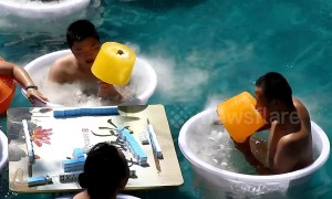 Chongqing residents enjoy giant 5 kg ice lollies to stay cool during heatwave