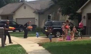 Police Officers Take Part In Good Old Super Soaker Fight