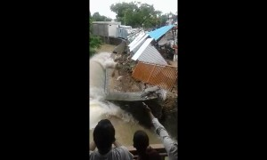 Shops on river edge collapse and get washed away in central Indian floods
