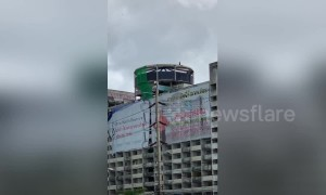 Demolition worker spotted swinging sledgehammer at 12-storey apartment block in Thailand