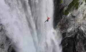 German daredevil rope swings off 850ft waterfall in Canada
