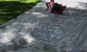 Kid Crashes on Slip and Slide