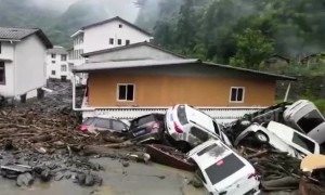 Strong rainstorm sees floods and mudslides wreck Chinese city, killing eight people
