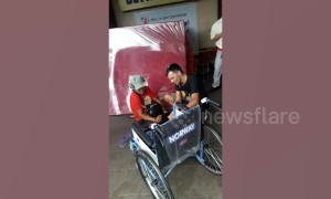 Heartwarming moment tourist gives brand new wheelchair to disabled man begging outside shops