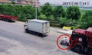 Scooter rider narrowly avoids being run over by truck in China