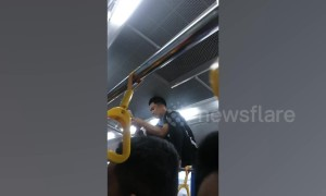 Bus conductor in the Philippines dubbed 'Spider-man' as he climbs over passengers' heads to collect fares