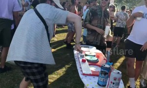 Man baffles UK festival-goers by DJing on an ironing board
