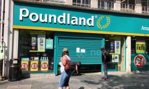 Poundland customers crawl into UK shop after shutter jams