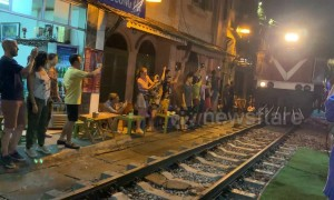 Tourists flock to Train Street in Hanoi, Vietnam