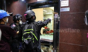 Hong Kong protesters destroy property they believe belong to triad gangsters
