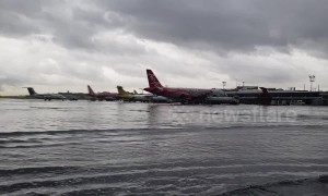 Planes stranded in knee-deep water after Tropical Storm Bailu floods airport