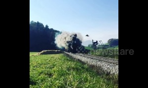 Crazy train! Incredible moment man does loco flip over moving locomotive