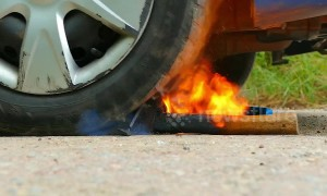 Incredible experiment as car tire takes on burning HOT axe
