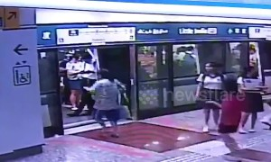 Woman in Singapore narrowly misses train then opens safety doors with her bare hands to climb inside