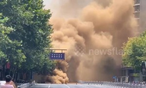Road collapses in China sending huge plumes of smoke into the sky