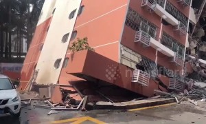 Six-storey residential block topples over onto another building in China's Shenzhen