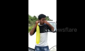 Indian man inflates 80cm balloon with his ear in bizarre feat