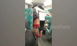 Kind-hearted train stewardess comforts passenger crying on carriage in Taiwan