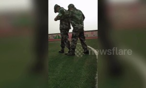 Chinese student is unable to coordinate his arms and legs during military training drill
