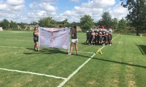 Tough Football Banner Prevents Team Entrance