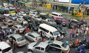 Cars cover zebra crossing during rush hour traffic in Bangkok