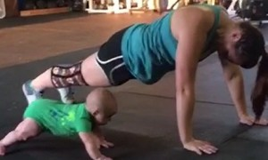 Baby keeps mommy motivated during intense workout
