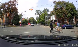 Cyclists Struggle at Stop Sign