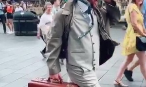 Street Performer Stuck in Time