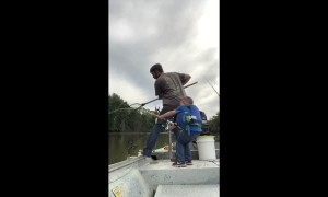 Happy Kid Catches Huge Fish