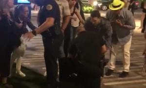 Woman Uses Her Heel to Hit Cop